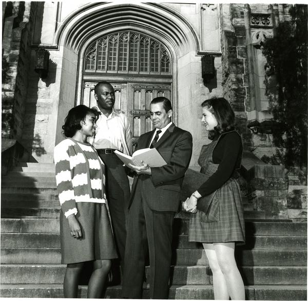 Students and faculty in front of Main Library, circa 1960